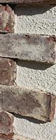 100年以上前のイギリスのアンティークレンガと石混じりの塗り壁。
